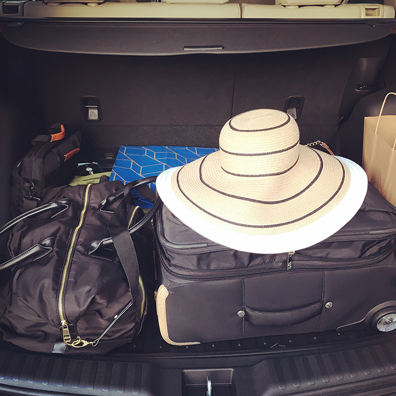 woman packed SUV for Labor Day getaway